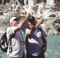 Throwing coins in the Trevi Fountain.....so we would return