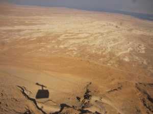 shadow of my cable car to the top at Masada with the Dead Sea in the distance