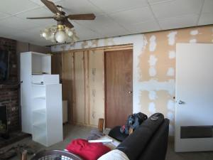 he had to tear down the paneling (Ken's handy work....) on this wall to even it out.