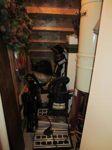 storage area under the stairs......jam packed!