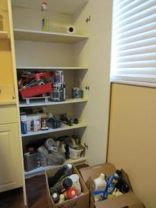 top two shelves cleaned and ready for something other than tools, tubes, and bottles of oil, cleaners etc.